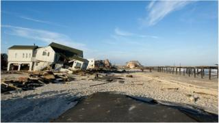 Ruined homes and the Surf Club in the distance on Ocean Avenue, Ortley Beach, New Jersey