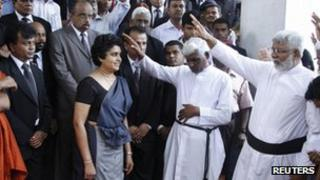 Chief Justice Shirani Bandaranayake is blessed by priests before her appearance in parliament on Tuesday