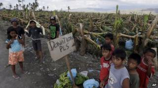 Residents appeal for aid in Montevista township, Compostela Valley, southern Philippines on 9/12/12