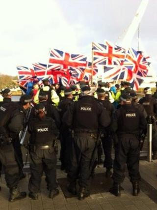 Loyalists carrying union flags marched over the Londonderry Peace Bridge