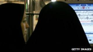 Women reading The Koran