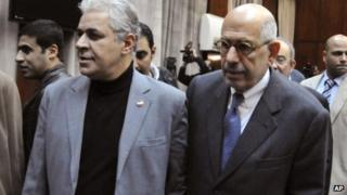 Egyptian opposition leaders Hamdeen Sabahi, second left, and Mohamed ElBaradei, center, arrive for a press conference in Cairo, Egypt, Wednesday, Dec. 5, 2012.