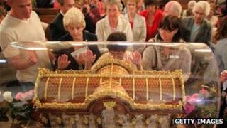 Pilgrims pray in a church in Coleshill, Warwickshire
