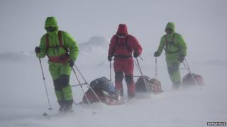 Team members sledge dragging in Greenland