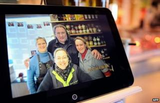 A photo taken on 12 December in the Belgian village of Estaimpuis shows a photo on a tablet featuring French actor Gerard Depardieu posing on 7 December with the local butcher and her employees