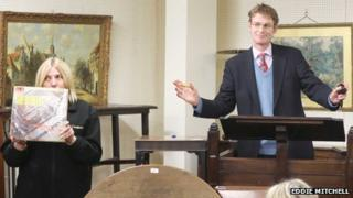Auctioneer Paul Campbell attempts to sell the album