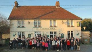 villagers outside The Green Man in Toppesfield