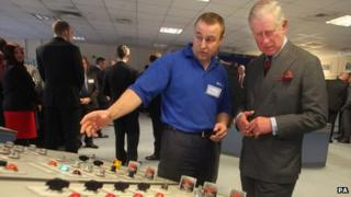 Prince Charles during his tour of Tata