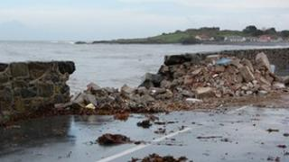 Damage to the road and sea wall at Perelle in Guernsey