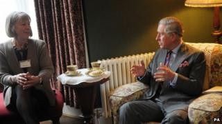 Prince Charles has tea in the living room of the birthplace of Dylan Thomas in Swansea with restorer of the house Anne Haden