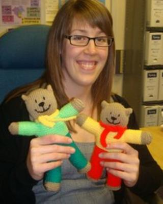Knitted bears being presented to hospitals by West Mercia Police