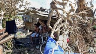People in a makeshift shelter in New Bataan, 12 December 2012