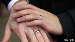 Hands of a same-sex couple