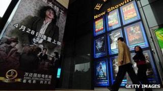 Cinemagoers arrive at Wanda International Cinemas in Beijing