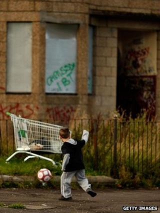 Child playing near derelict housing