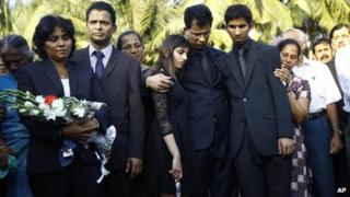 Jacintha Saldanha's family embrace at her burial