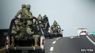 Mexican marines ride in convoy