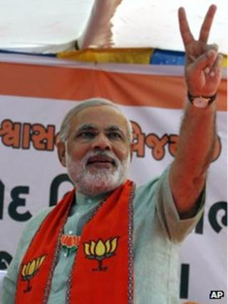 Gujarat state Chief Minister Narendra Modi flashes a victory sign during an election campaign rally for state assembly elections at Prantij in Ahmadabad, India, Saturday, 15 Dec 2012