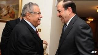 Jalal Talabani (L) and Nuri al-Maliki at a meeting on Monday