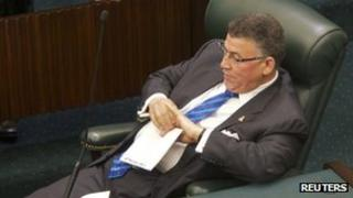 McKeeva Bush listens to speeches during the session called to debate a motion of no confidence in him