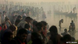 Hindu pilgrims gather to bathe at sunrise at the ritual bathing site at Sangam, the confluence of the Ganges, Yamuna and mythical Saraswati rivers during the Ardh Kumbh Mela festival (Half Pitcher festival) January 23, 2007