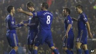 Chelsea players celebrate their fifth goal, scored by Fernando Torres