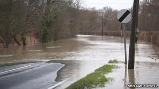 Road flooded in Toft, Cambridgeshire