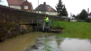 Environment Agency staff clearing out trash near Northampton
