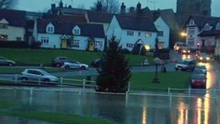 Christmas tree in flood water in Finchingfield, Essex