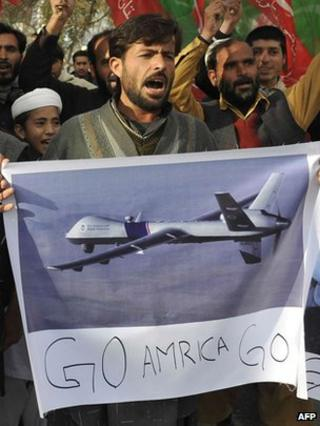 Supporters for Imran Khan, the cricketer turned politician, protest against drones
