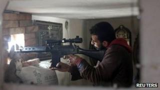 A Free Syrian Army sniper in Aleppo, 21 December 2012