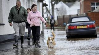 Residents in a flooded street in Devon