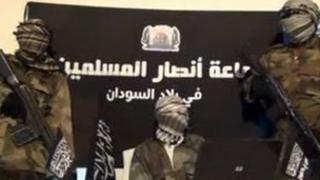 An image from a video released by Jama'tu Ansarul Muslimina Fi Biladis Sudan, the Islamist group known as Ansaru, which reportedly shows unidentified members of the group speaking in an undisclosed place in November 2012