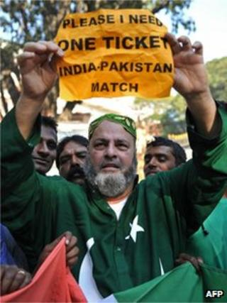 Mohammed Bashir, a 60-year old US-based Pakistani cricket fan, holds up a placard seeking a spare ticket on the eve of the India-Pakistan cricket series in Bangalore on December 24, 2012.