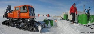 Clearing snow from the fuel drums