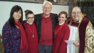 Sir Anthony Hopkins, pictured with his wife Stella Arroyave, the choristers and Canon Dorrien Davies