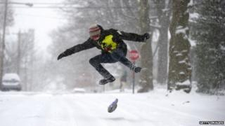 Teenager snowboards down road in Pennsylvania