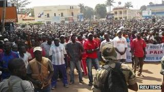 Residents of Bangui listen to an appeal for help by CAR President Francois Bozize. 28 Dec 2012