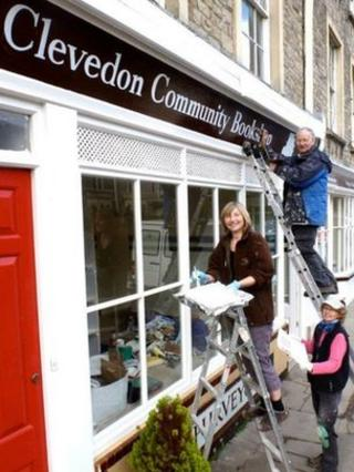 Painting the sign on the new bookshop