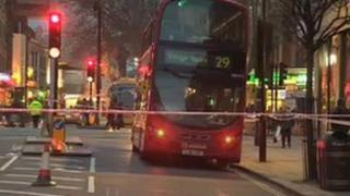 Bus behind police tape