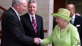 The Queen and Sinn Fein's Martin McGuinness shake hands in Belfast