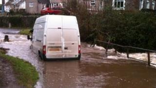 A man was trapped after a van became stuck in water on Gower
