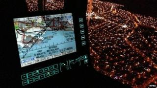 Night time view over Canvey Island from inside the Essex-based police helicopter