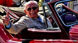 Graham Furley in a vintage Jaguar at Staverton airfield