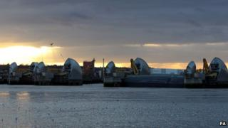 Views of the closed section of the Thames Barrier from Silvertown, Docklands, after heavy rain