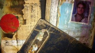 The charred remains of Victor Prazak's passports, returned to his widow years after the Flight 1103 disaster