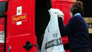 Royal Mail worker collecting post