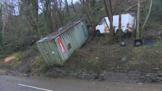 Storage container and van caught in landslide