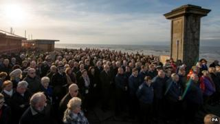 People attend the memorial service in Gynn Square, Blackpool