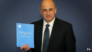 Lord Justice Leveson with his report